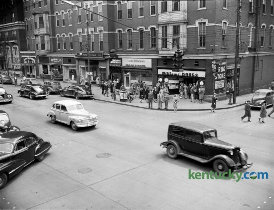 Southeast corner of Limestone and Main streets in 1947.  This corner is currently occupied by Phoenix Park. The photo was taken to run with a story about increased congestion that was expected as a result of an ordinance passed by the Board of City Commissioners that would allow the Lexington Railway System to erect a change-making and information booth there. Published in the Lexington  Leader, May 8 1947.