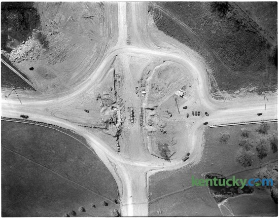 """Aerial view of construction of the intersection of New Circle Rd. and Winchester Rd, Jan. 1951. The intersection was a clover leaf design until June 2000 when it was changed into the """"urban diamond"""" interchange it is today. The new interchange was the first urban diamond in Lexington and one of a handful in the state. Urban diamonds are often used in tight situations, where there's little space to expand the interchanges."""