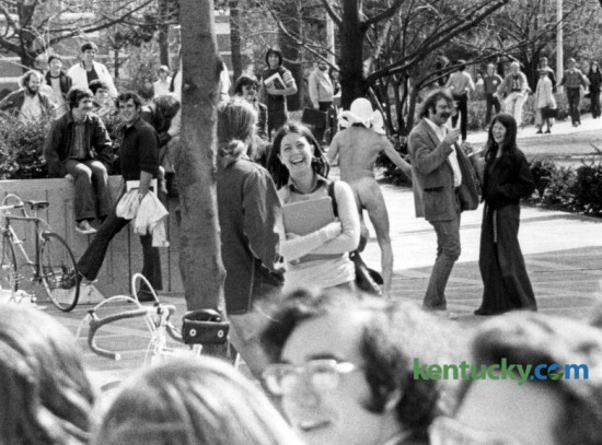 A  masked streaker evoked humor on March 5, 1974 from University of Kentucky students as he ran across the patio on central campus apparently  as a protest to the UK Board of Trustees, which was meeting at the Patterson Office Tower on March 5, 1974. The trustees were unaware of the incident. The high point of streaking's pop culture significance was in 1974, when thousands of streaks took place around the world.  Photo by E. Martin Jessee | Staff