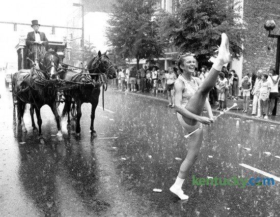 The July 4th parade in downtown Lexington was a wet one in 1981. Photo by David Perry, Herald-Leader staff