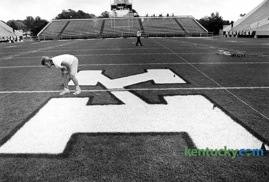 James Flora of Lexington checks the big K at midfield of Commonwealth Stadium Sept. 5, 1991 before UK football's season opening game against Miami of Ohio. Note the endzone seats are not closed in. That part of the stadium was renovated in 1999. Photo by Tom Marks | Herald-Leader staff