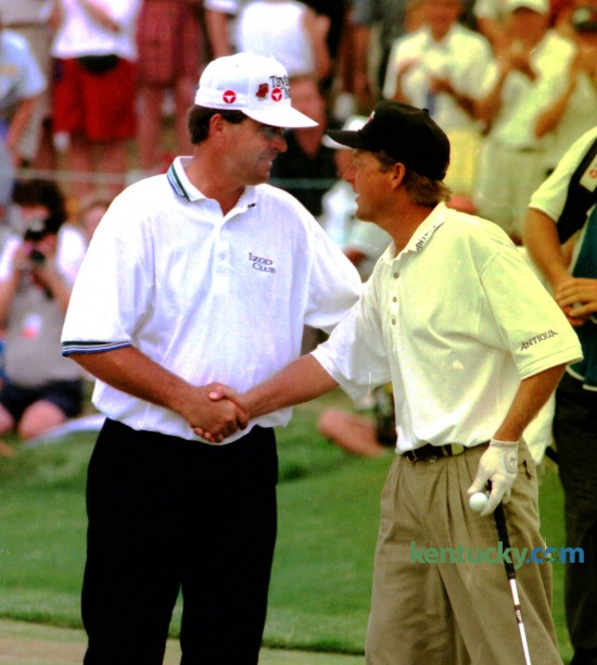 Kenny Perry, left, shook hands with Mark Brooks after Brooks won the PGA Championship August 11, 1996 at Valhalla Golf Club in Lousiville. Brooks won on the first hole of a sudden-death playoff. Perry, a Kentucky native, was discussing his own comeback with CBS commentators when Brooks tied him on the 18th hole. Photo by Michelle Patterson | Staff