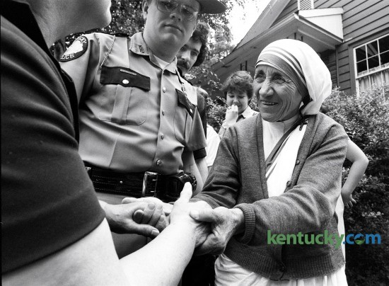 Mother Teresa shook the hands of a well wisher upon her arrival in small eastern Kentucky town of Jenkins on June 19, 1982. She was there to open her first Appalachian mission established by her order, The Missionaries of Charity.  Photo by Charles Bertram | Staff