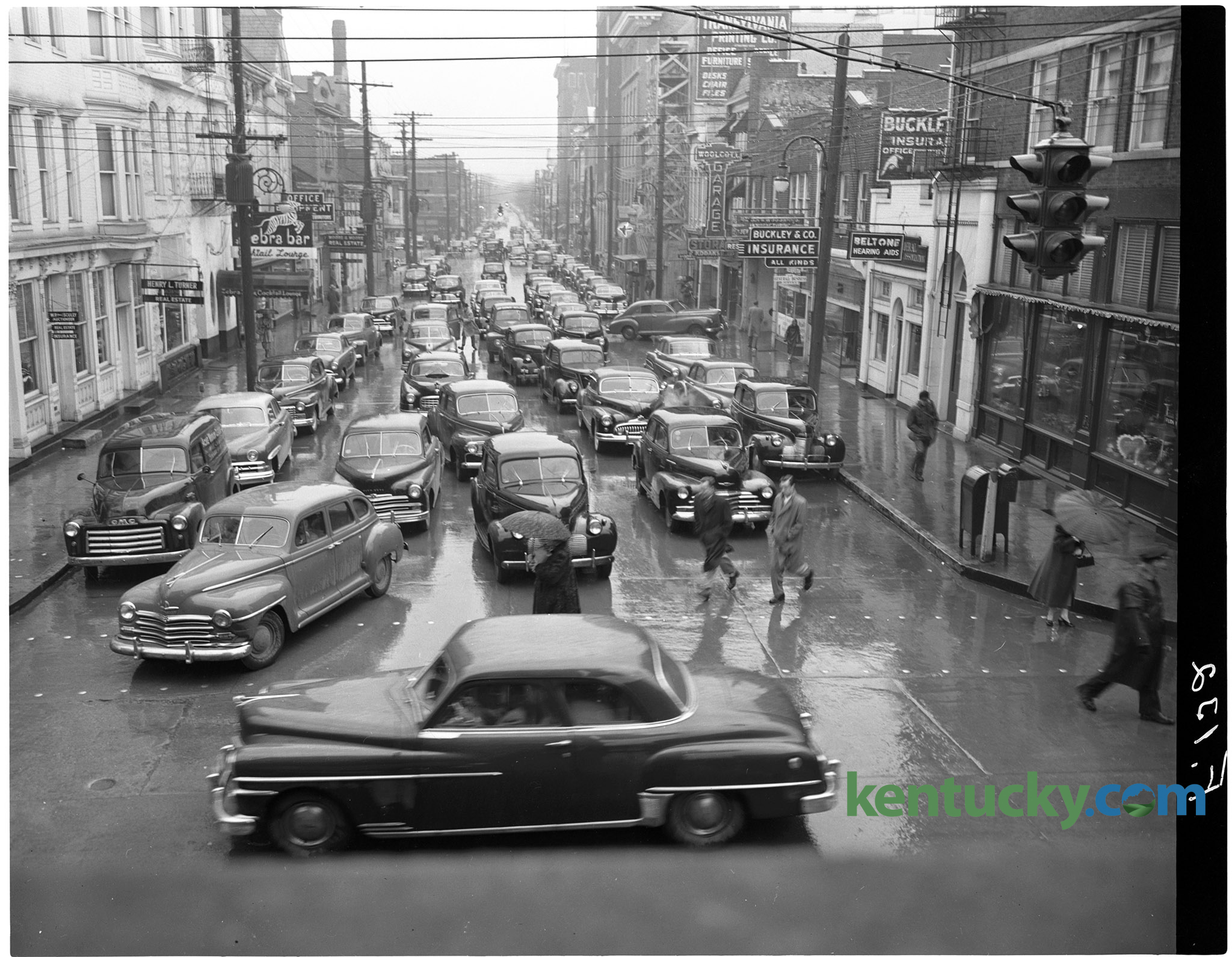 Noon hour traffic jam on Short Street in downtown Lexington. Published in  the Lexington Herald