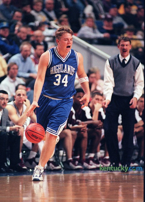 Highlands guard Jared Lorenzen yells a play during an opening round game in the Boys' Sweet Sixteen March 11, 1999 in Rupp Arena. Henderson Co. rallied to stun Highlands, 62-60, ending Lorenzen's high school basketball career. He later went on to play quarterback for the University of Kentucky football team. Lorenzen, along with fellow star and UK-football signee Derek Smith, led Highlands to an undefeated season and a second Class 3A football title in three years during the fall of his senior year in high school. In basketball, the Bluebirds made their third consecutive appearance in the Sweet Sixteen. Lorenzen, who was listed as a 6-4, 240-pound forward, contributed 14 points, 8.6 rebounds and five assists a game that year. Photo by Charles Bertram | staff