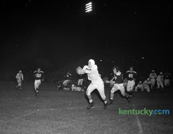 "Wallace ""Wah-Wah"" Jones caught Bill Boller's 11-yard pass for a touchdown during Kentucky football's 70-0 win over Xavier Oct. 5, 1946 at Stoll Field. Wallace ""Wah Wah"" Jones, widely considered the greatest all-around athlete in UK history, played both football and basketball for the Cats. As such, he held the distinction of playing for two lionized coaches: Adolph Rupp in basketball and Paul ""Bear"" Bryant in football. On the gridiron Jones was was an all-Southeastern Conference player and on the hardwood he was a member of the Fabulous Five, the basketball team that in 1948 won the first of UK's eight national championships."