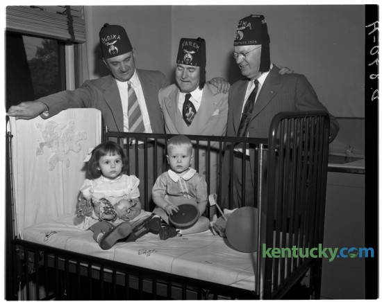 University of Kentucky basketball coach Adolph Rupp, left, Charles Galloway Calhoun, Shriners imperial potentate and Fred Bryant posed for a picture at Shriner's Hospital in Lexington with Barbara Scully and Gary Meadows in June of 1949. Published in the Lexington Leader June 23, 1949.