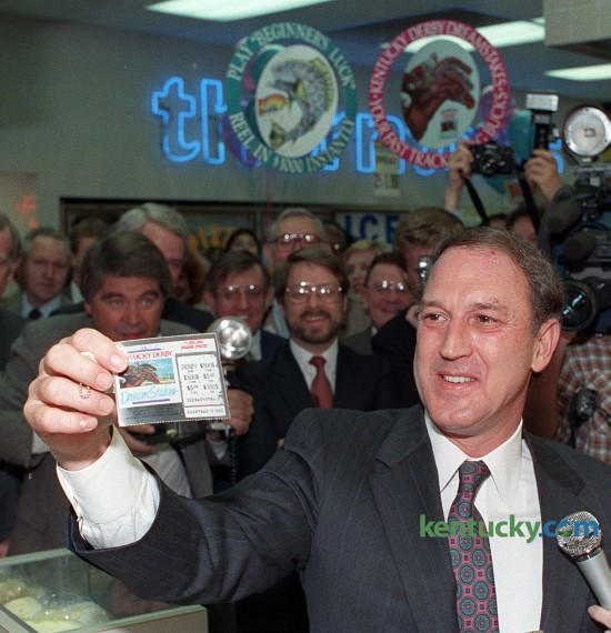 "Kentucky Gov. Wallace Wilkinson bought the first offical lottery ticket at a Thorntons gas station and food mart in Louisville April 4, 1989. Wilkinson, who made the creation of a lottery the cornerstone of his 1987 gubernatorial race, bought $3 worth of tickets and came up empty. Wilkinson turned and jokingly told lottery President Frank Keener that he ""could have organized this a little better."" The governor later bought $100 worth of tickets -- 50 ""Beginner's Luck"" and 25 ""DreamStakes"" -- for his wife, Martha. Kentucky voters overwhelmingly supported the lottery in last fall's general election. The Kentucky Lottery Corporation says it has earned nearly $4 billion for Kentucky's state treasury since 1989. Photo by Frank Anderson 