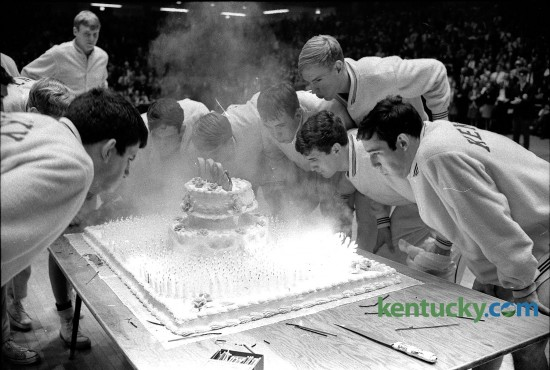 After defeating Tennesse on the road, the Kentucky basketball players came home to Memoral Colesium in Jan. 1969 to blow out 1,000 candles on a large cake celebrating the program's 1,000th win. The Cats will go for win number 2,141 Friday against Grand Canyon. In 112 seasons, UK has lost only 672 games. Photo by E. Martin Jessee | staff