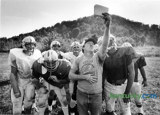"Corbin High School football coach Larry ""Cotton"" Adams checks out a play with his team during practice Sept. 27, 1983. Adams played for Corbin in the early 1960s and served as an assistant for 13 seasons before moving up to head coach in 1981. His 14-year record was 114-46, highlighted by a Class 2A state championship in 1982 and a runner-up finish in 1990. The 2014 Redhounds take on Central in the third round of the Class 3A playoffs today. Photo by Charles Bertram 