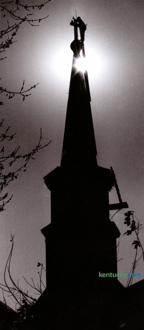 Phillip Quinn of Lexington, a self-employed steeple jack, worked to repair the cross on top of the steeple of the Catholic Church of the Annunciation in Paris, Ky. November 9, 1989. Photo by Clay Owen