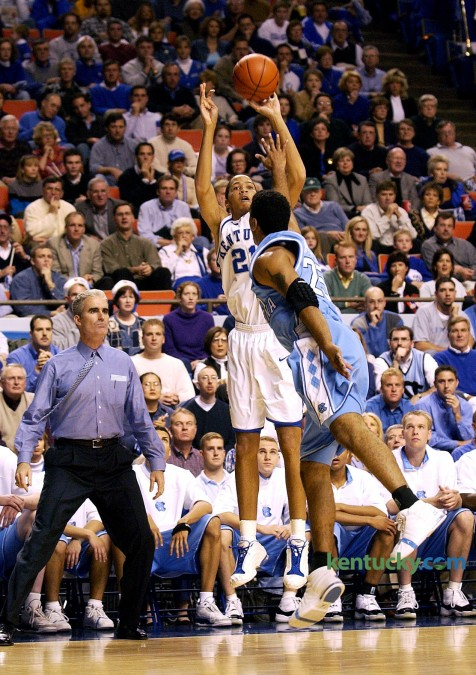 "Tayshaun Prince shoots one his five made 3-pointers to open the Dec. 9, 2001 game against North Carolina in Rupp Arena. The senior electrified the home crows with his five consecutative treys in the the first three minutes and 46 seconds of the game. Prince went on to make his first seven shots, six from three-point range, and eight of his first nine (seven of eight from three-point range). He finished with a career-high-tying 31 points in Kentucky's 79-59 win. ""He hit some ridiculous shots,"" said Tar Heels Coach Matt Doherty, shown next to Prince on the UNC bench. Photo by Helena Hau 