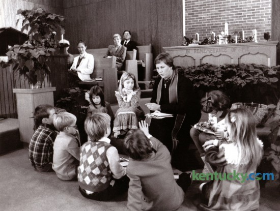Reverend Jan Ehrmantraut talked to children during the Children's Moment at Sunday morning worship service at Antioch Christian Church in Lexington, December 14, 1986. Photo by John C. Wyatt | Staff
