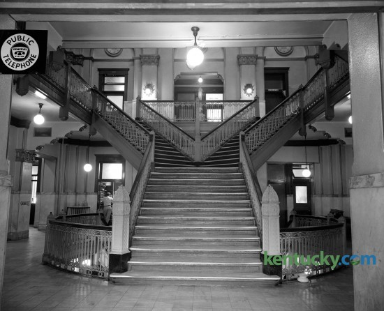 Interior of the Fayette County Courthouse in August of 1960 showing the Y-shaped stairwell that led to offices and court rooms on the second and third floors.  Construction on this, the fifth Fayette County Courthouse, began in July of 1898 and was finished February 1, 1900. The new courthouse was a Richardson Romanesque style, a three-story stone masonry building, with a dome, clock and cupola (with weather vane). In 1960-1961, the interior of the courthouse was extensively renovated, to provide more courtrooms and offices.  These renovations included the removal of the interior Y stairs and closing off the dome. The last trial was held in the courthouse in 2002 and in 2003 the Lexington History Center opened. During 2012, the courthouse was closed to the public due to lead paint and asbestos found in the upper floors.  Proposals are under currently under consideration to restore the courthouse to the original design. Published in the Lexington Herald-Leader August 28, 1960.