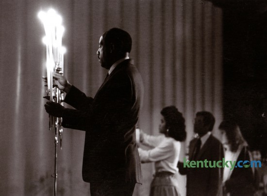 Lewis Stout, left, helped light candles during a Martin Luther King, Jr. Memorial Service in Memorial Coliseum on the University of Kentucky campus, Sunday January 18, 1987. Photo by J.D. VanHoose | Staff