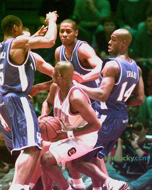 South Carolina's B.J. McKie was surrounded by UK's Wayne Turner, left, Jamaal Magloire and Heshimu Evans during Kentucky's game against the Gamecocks in Columbia, South Carolina January 5, 1999. UK won 68-61. UK was coached by Tubby Smith in his second year and the team finished ranked 8th in the country by AP. The team lost to Michigan State in the Midwest Regional in St. Louis. Photo by Frank Anderson | Staff