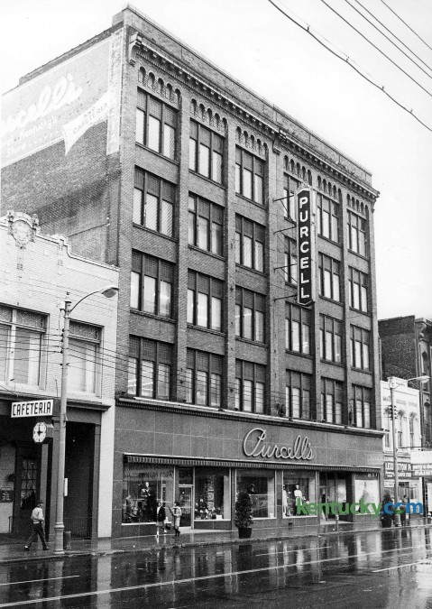 Purcell's department store in downtown Lexington at 320 W. Main St., Nov. 5, 1967. Purcell's, which opened in 1887 as a 5 &10 called the Racket Store, originally was located on the north side of West Main Street. In 1923, its founder, Jefferson Davis Purcell, bought property on the south side and opened a department store at 320 W. Main St. It was later enlarged. In its heyday, during the 1940s and '50s, Purcell's was not only one of Lexington's busiest, but one of its most colorful department stores. Customers often bypassed the crowded elevator so they would not miss anything on display in the store's 22 departments. It was one of the first in the city to have a live Santa Claus and strolling carolers at Christmas. At one time, the store carried 75,000 charge accounts, said Stanhope Wiedemann, president and CEO of the department store his grandfather founded. Among the many promotions it sponsored were embroidery and meat-carving schools and a table-setting contest. In 1951, at the request of a Lexington man, employees boxed the man up in a crate and delivered him, engagement ring in hand, to his girlfriend's home. She accepted. In 1970, after several stores left downtown, Purcell's closed. The building was razed in 1980 to make way for the $50 million Vine Plaza, which includes the Radisson Hotel and parking garage. Herald-Leader staff photo