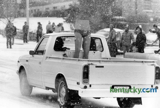 A driver goes down Limestone Street in Lexington with the bottom half of a mannequin wearing only underwear in the bed of his pick-up truck, February, 1979. Photo by Ron Garrison | staff
