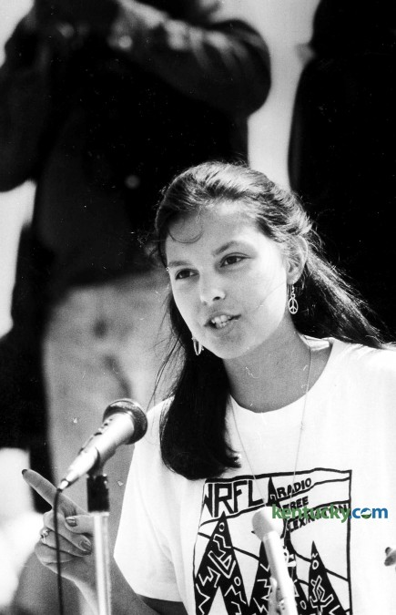 """20-year-old Ashley Judd speaking at a April 14, 1988 protest march at the state capitol in Frankfort demanding the resignation of University of Kentucky trustee A.B. """"Happy"""" Chandler."""" In the week prior, the 89-year-old Chandler used of a racial slur at the board's investment committee meeting. About 200 people marched on the state Capitol demanding Chandler's removal from the board. Gov. Wallace Wilkinson met the hostile crowd on the steps and urged forgiveness for Chandler, who had endorsed him in his 1987 gubernatorial campaign. Protesters booed Wilkinson when he said he would not remove Chandler from the UK board. Judd, the daughter of Naomi Judd and the sister of Wynona Judd, the award-winning country music duo from Ashland, told the crowd """"I know Governor Wilkinson, and I think he was a little surprised because I was a white, middle-class person in this predominantly black crowd."""" Judd, then a UK sophomore majoring in history and French, rounded up students to join the march. She walked through the halls of classroom buildings pleading with students to leave their classes and join the rally. Shouting """"Stop racism everywhere"""" and """"Let's walk out and let's go to Frankfort,"""" Judd and a few other members of the United Student Association for Racial Justice attracted about 50 UK students to make the trip to Frankfort. When Chandler celebrated his 90th birthday later in the year, he told a reporter he had no regrets about anything during his long and colorful public career. """"I wouldn't change a jot or tittle,"""" said Chandler, who died in 1991. Photo by Stephen Castleberry 