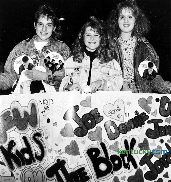 "From left, Laurie Beaven, 12, Amy Lanham, 12, and Melissa Gordon, 13, wait for the begining of the New Kids on the Block concert to begin Jan. 13, 1990 at Rupp Arena. The trio came from Spingfield and brought the homemade banner with them. With parents in tow, young girls wearing New Kids on the Block T-shirts, jackets, buttons, hats and bandanas flooded the Lexington Civic Center, waiting to get in to see the popular singing group. They paid at least $18.50 apiece for the opportunity. At the time of this nearly sold-out show of 21,000, the group had vaulted to teen stardom with three hits -- ""This One's for the Children,"" ""Cover Girl"" and ""Didn't I (Blow Your Mind)."" The first two numbers of the New Kids' 90-minute concert -- ""My Favorite Girl"" and the beat-crazy ""What'cha Gonna Do About It"" -- were almost totally drowned out by the crowd, which shrieked and shrilled at every move the group made. Just how loud was the crowd? Well, let's put it this way. Earplugs were being sold at the concession stands. Photo by James D. VanHoose 