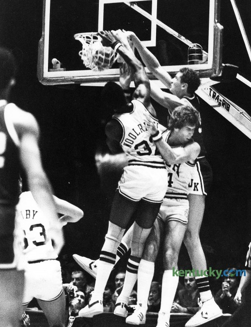 Kentucky's Sam Bowie dunks over Notre Dame's Orlando Woolridge, left, and Kelly Tripucka Dec. 27, 1980 at Freedom Hall in Louisville. Bowie led UK with 18 points but it wasn't enough as the eight-ranked Irish won, 67-61 behind Tripucka's 30 points and Woolridge's 15. It was the first defeat of the year for the No. 2 ranked Wildcats, who would go on to finish the season with two consecutitive losses en route to a 22-6 record. Photo by E. Martin Jessee | staff