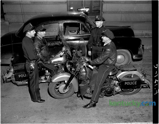 From left, Lexington policemen Lloyd Lindsay, Claude Ginter, William Foster and Bryan Henry chat. Published in the Herald-Leader January 14, 1951. Herald-Leader Archive Photo