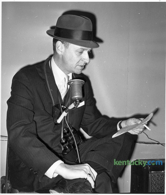 """Cawood Ledford broadcasts a Keeneland race in April 1964. He was better known as the """"Voice of the Wildcats"""" for 39 years as the play-by-play announcer for the University of Kentucky basketball and football teams from 1953-1992. His last UK basketball game was the Christian Laettner game in the NCAA Tournament when Kentucky fell to Duke 104-103 in overtime. Ledford, who died in 2001, would have turned 89 on April 24. Herald-Leader file photo"""