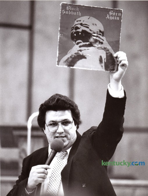 """Michael Watson, an evangelist from Buhl, Ala., held up a Black Sabbath album January 10, 1986 during a revival at the Winchester Church of God Cathedral entitled """"Rock of the 80's - A Christian Perspective on Rock Music."""" The revival also featured the burning of rock records and tapes.  Photo by David Perry 