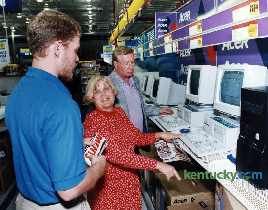 Jim and Rachel Daniels of Frankfort, got some help in shopping for a new computer system from Best Buy salesperson Noah Cyboron Oct. 4, 1994. Note the price for the machine they were looking at: $1,296. Photo by Drew Fritz