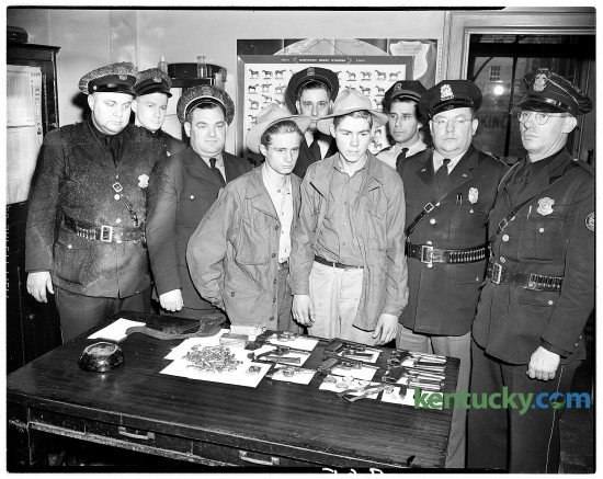 Albert Earl Little John, left, and Clayton Eversole were charged with looting a Berea hardware store in January, 1947. Guns and other items they took are on table in front of them. Published in the Lexington Leader January 31, 1947. Herald-Leader Archive Photo