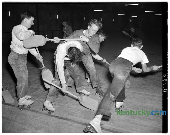 Broomball hockey being played at Scott's Roll-Arena in Lexington. The photo shows the Black Raiders and the Eight-Balls scrambling for the inflated volleyball. Published in the Herald-Leader February 20, 1949. Herald-Leader Archive Photo