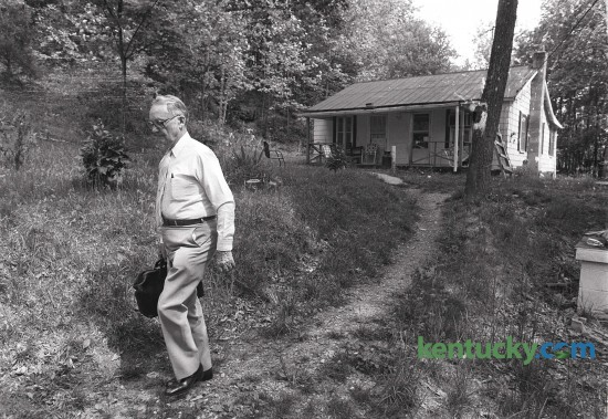 Dr. Mack Roberts making a house call on Span Hill in Monticello, Ky. in the summer of 1987. Dr. Roberts practiced medicine in Wayne County for 61 years until his retirement in 1993. He died in March of 2001 at the age of 97. Dr. Roberts  continued making house calls until his retirement. Photo by Charles Bertram | Staff