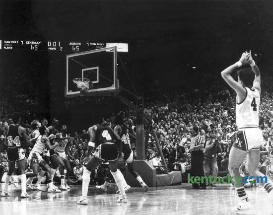 University of Kentucky's Kyle Macy, right, watched as his game-winning, last second shot January 2, 1980 against Auburn in Rupp Arena goes down. The Cats won 67-65 behind Macy's game-high 21 points on 9 of 13 shooting. Photo by E. Martin  Jessee | Staff