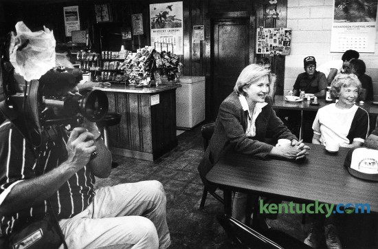 "Television journalist Diane Sawyer, center, talks to farmers in Pam and Erma's Restaurant in Bath County, Sept. 2, 1992. An ABC news crew and Sawyer, a Kentucky native, filmed footage for a program on welfare reform. The segment on ABC's ""PrimeTime Live"", examined the welfare economy and the chronic shortage of labor on Kentucky tobacco farms. After the piece aired, several Kentucky farmers featured were stunned by the portrayal of rampant abuse. Sawyer and an ABC news crew took hidden cameras to 30 welfare offices and other sites nationwide showing several people cheating the system. John Botts, a Bath County tobacco farmer who was interviewed at Erma and Pam's Restaurant in Bethel, said the program showed ""why our country is in the shape it is in."" Welfare, he said, is a good program, but too many people abuse it. Photo by Tim Sharp 