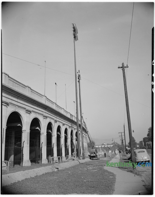 One of six 100-foot steel poles erected on Stoll Field for illumination of night football games in September of 1946. The field has been in use since 1880, but the concrete stands were opened in October 1916, and closed following the 1972 season, replaced by Commonwealth Stadium. Published in the Lexington Leader September 16, 1946. Herald-Leader Archive Photo.