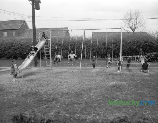 One of the playgrounds in the African American section of the Bluegrass-Aspendale housing project in Lexington's east side in April 1954. An eight-foot fence separated blacks and whites from 1939 until January 1974. Published in the Lexington Herald-Leader April 18, 1954. Herald-Leader Archive Photo