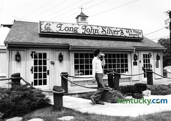 Gene Stathas leaves after dinning June 8, 1981 at the very first Long John Silver's location at 301 Southland Drive in Lexington. Origionally called the Cape Codder, Jerrico Inc. renamed it Long John Silver's and opened for business on Aug. 18 1969. Lexington-based Jerrico also operated Jerry's restaurants and founded Fazoli's. Jerrico was taken private in 1989 in a $626 million leveraged buyout, leaving Long John Silver's with $275 million in high-interest debt. The company struggled with the debt, and Long John Silver's sought bankruptcy protection in June 1998. A year later, A&W bought the chain for $220 million and then was bought by Louisville-based Yum Brands several years later. Private investors made a successful bid to buy the LJS Brand in September 2011. There are currently just over 1,100 locations worldwide, however this origonal location is now a styling salon. Photo by Charles Bertram | staff