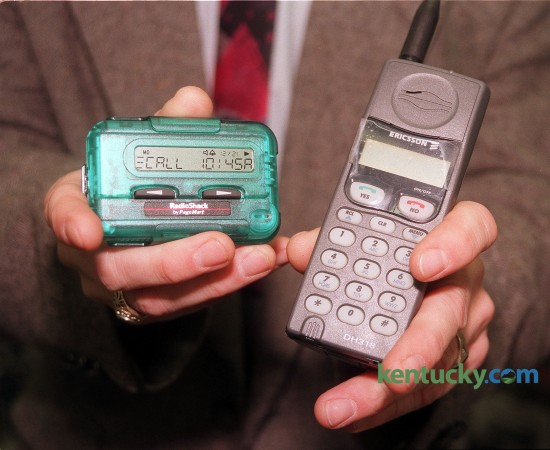 A pagers and cellular telephone available for sale at Radio Shack in Tates Creek Center, Dec. 1. 1997 in Lexington. This photo went with a story on high-tech gadgets for Christmas shoppers. Photo by Greg Perry