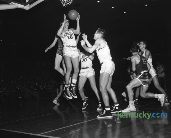 University of Kentucky's Lou Tsioropoulos (16) grabbed a rebound against Duke in the Kentucky Invitational Tournament at Memorial Coliseum December 21, 1953. Kentucky won 85-69. UK went undefeated for the season but declined an NCAA bid. Tsioropoulos  died on Saturday in Louisville.He would have been 85 next Monday. Unpublished. Herald-Leader Archive Photo