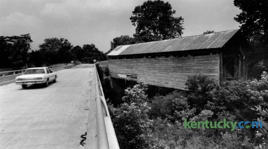 Kentucky highway 158 runs beside Ringo's Mill covered bridge in Fleming County south of Hillsboro.  The 90-foot-long single span Burr truss bridge was built in 1867 and served as a link to Ringo's Mill, a grist mill operated during the 1800's. Photographed June 30, 1981. Photo by Charles Bertram   Staff