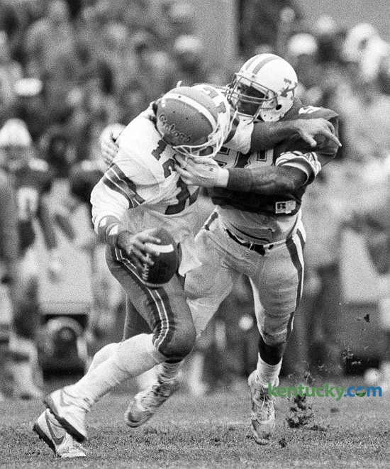 The University of Kentucky's Carwell Gardner sacks Florida's Kerwin Bell during UK's 10-3 victory over the University of Florida on Nov. 15, 1986 at Commonwealth Stadium in Lexington. The win snapped a six-game losing streak against the Gators. Unfortunately for Kentucky, the Cats have not beaten Florida since that game, suffering 28 straight losses to the Gators. Photo by Charles Bertram | staff