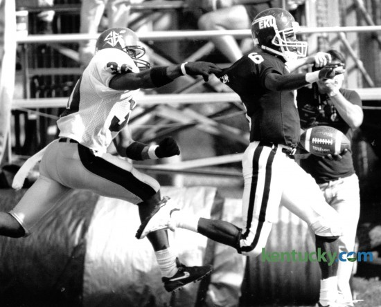 South East Missouri State's Steve Bryant, left, made a touchdown saving tackle on Eastern Kentucky University's Kenny McCollum after he made a long gain on an end-around run early in the third quarter at EKU on October 3, 1992. EKU won the game 20-10. Photo by Charles Bertram | Staff