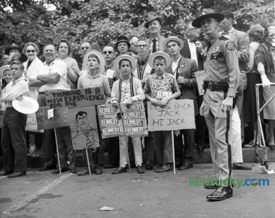 A Kentucky State Trooper and supporters of Democratic presidential candidate Sen. John F. Kennedy awaited his arrival on the University of Kentucky campus as he made a campaign stop in Lexington on October 8, 1960. Herald-Leader Staff Photo