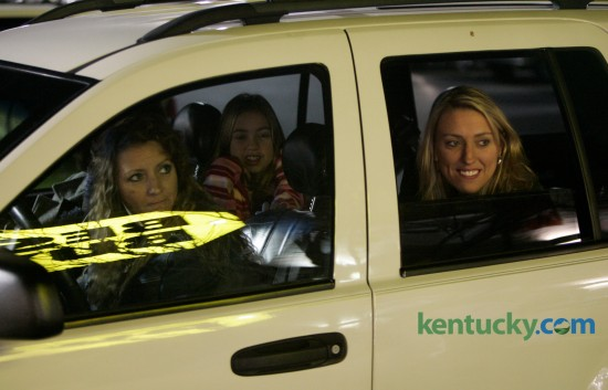 Four generations of shoppers, great-grandmother Jo Ann Cox, in the front passenger seat, grandmother Karen Roberts, left, mother Kellie Sparks, right, and great-granddaughter Mariah Polly, all from Lawrenceburg, keep warm in their car instead of standing in line to get into Best Buy which opened at 5 a.m. on Black Friday, the traditional first day of the holiday shopping season, in Lexington, Ky., on Friday, November 25, 2005. David Stephenson | Staff