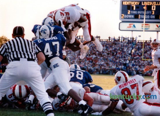 In the second quarter, U of L halfback Anthony Shelman dove over the Wildcat defense for Louisville's first touchdown in the first Governor's Cup on September 3, 1994 in Commonwealth Stadium. Kentucky went on to win game 20-14. Photo by David Perry | Staff