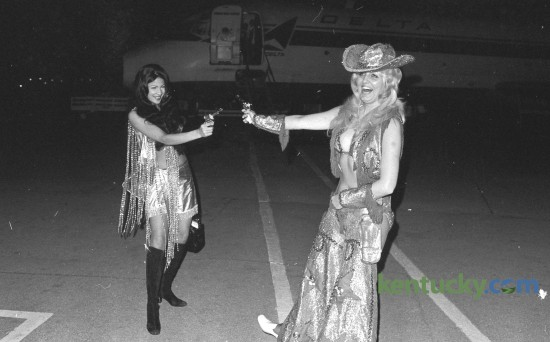 """Exotic dancers Vienna Ithier, left and Patricia Sands offered a not-so-fiery protest against airport """"anti-hijacking"""" security measures at Blue Grass Field May 13, 1973. They wore their costumes on the plane from Chicago so the outfits wouldn't be mishandled by airport security. They claimed garments from their on-stage wardrobe were continuallly being """"ripped and torn"""" by security police at various airports. The entertainers, in Lexington for a nightclub engagement, were clowning for news photographers after disenbarking. Herald-Leader Archive Photo"""