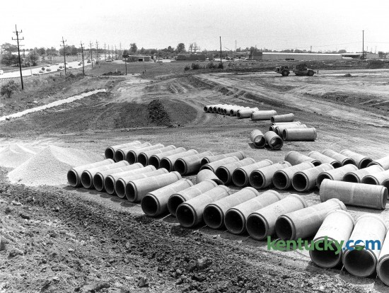 Storm and sanitary sewer construction along Nicholasville Road, shown at left, May 8, 1985. The area show is just south of Fayette Mall, around what is now the Courtesy Acura dealership and Bella Notte restaurant. In the background, West Tiverton Way can bee seen running horizontally across the picture. Visible it is Brecher's Lighting store, which is there today and a Lowe's home improvement store. This location closed when a newer, bigger Lowe's was built just up the road in a shopping center near the Man o'War intersection in the spring of 1998. Click on the image for a larger view. Photo by David Perry | staff
