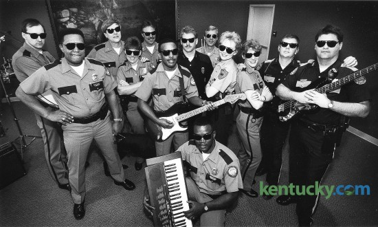 In 1993, Lexington police officer Debbie Wagner, fourth from the left, organized the DARE 911 Band, which used rock music to spread an anti-drug message to area schools. The group, photographed on Feb. 9, 1993, were made up of members of The Lexington Police, Fayette Co. Sheriff's Dept., University of Kentucky Police, and the Horse Park Police. Wagner, a 38-year veteran of the force known for community outreach, retired from the Lexington police force in January, 2016. Photo by Charles Bertram | staff