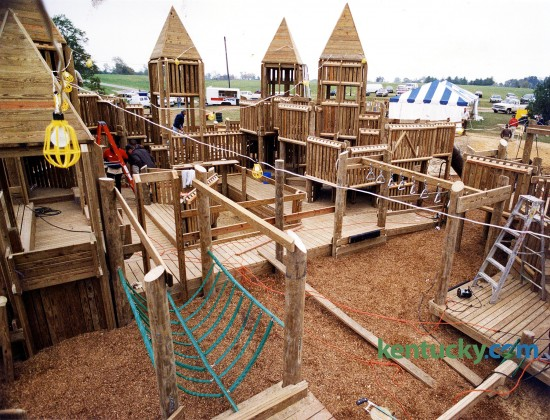 Construction of the wooden playground structure at Jacobson Park in Lexington, Oct. 11, 1993. The popular mazelike playground at the Richmond Road park was Lexington's third creative playground. Picadome Elementary School playground was the first -- followed by the Shillito Park project. About 2,500 volunteers contributed toi the completion of the playground. When it opened about two weeks later, it was the largest iplayground n Kentucky, featuring 30,000 square feet of slides, swings, turrets, bridges and hiding nooks. Photo by Mark Cornelison | staff
