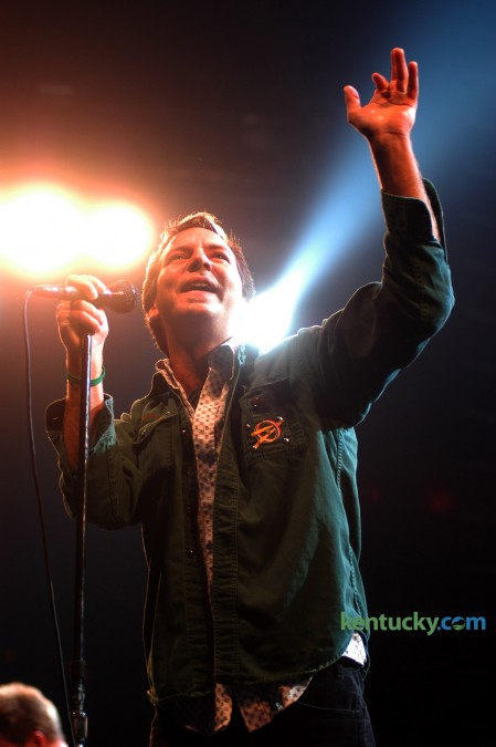 Singer Eddie Vedder greets the Rupp Arena crowd April 21, 2003 as Pearl Jam played Lexington for the first time. The Seattle band, which has been together since 1990, played before 10,000 at Rupp Arena. 13 years later to the week, the reticent torchbearer of the grunge generation of the 90's visits Rupp Arena for a nearly sol-out show. Photo by Mark Cornelison | staff